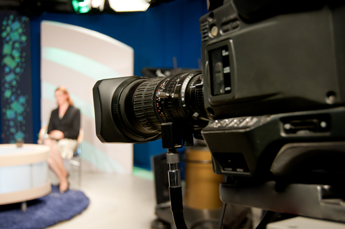 A video camera in focus shooting a talk show